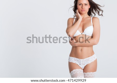Sexy woman in a white lingerie on the white background