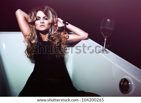 sexy woman in bath with red wine