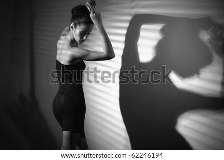 sexy woman in black dress dancing - stock photo