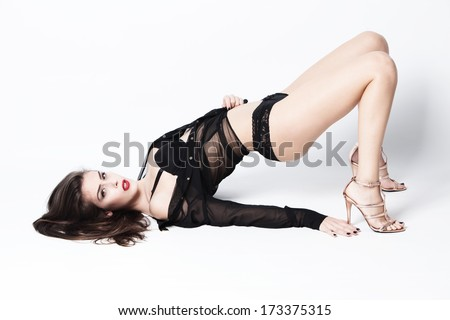 sexy woman in black lingerie,  transparent shirt  and high heel shoes full body shot, studio