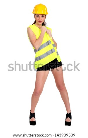 Sexy woman in construction wear - stock photo