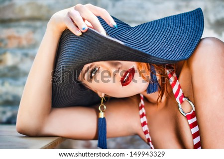 Sexy woman in hat, outdoor portrait - stock photo