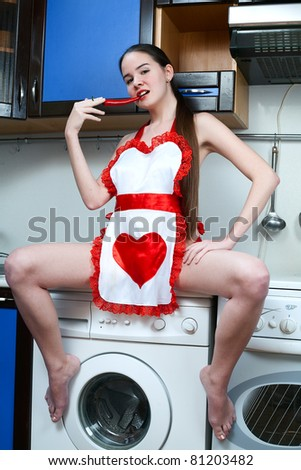 sexy woman in kitchen with hot pepper - stock photo