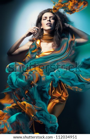 sexy woman in paint waves - stock photo