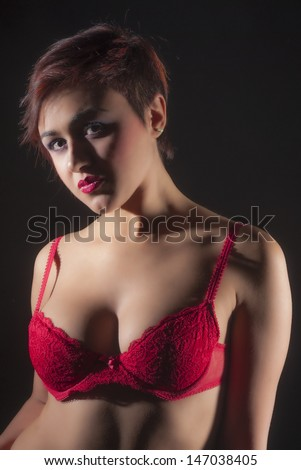 Sexy woman in red lingerie isolated on black background - stock photo