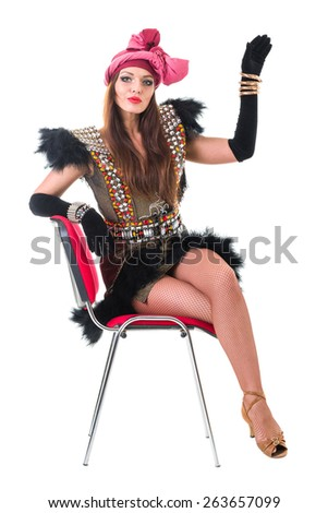 sexy woman in retro dress on a chair isolated on white background in full length