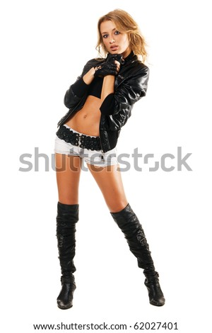 Sexy woman in rock style clothing against white background
