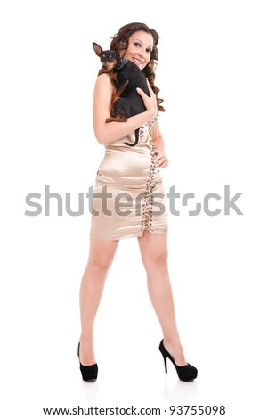 sexy woman in short dress holding her puppy, isolated on white background - stock photo