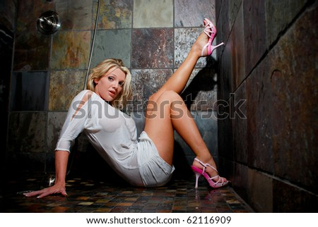 Sexy Woman In Shower Wearing Pink Heels and White Dress - stock photo