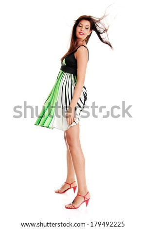 Sexy woman in skirt blown by wind, isolated on white background