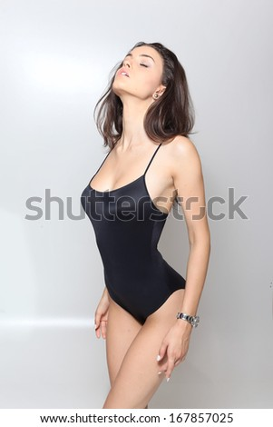 sexy woman in swimsuit posing glamorous in the studio  - stock photo