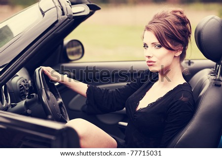 Sexy woman in the car - stock photo