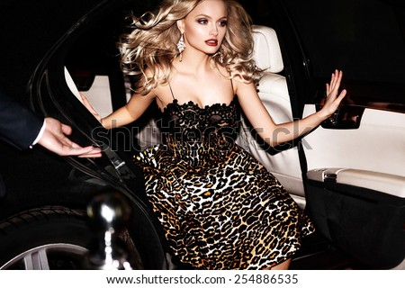 Sexy woman in the car. Hollywood star. - stock photo