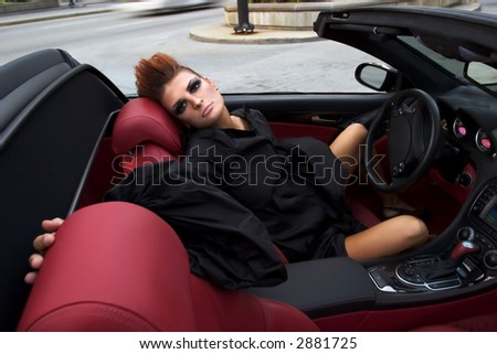 Sexy woman in the luxurious car - stock photo