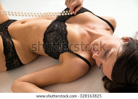 sexy woman in underwear and with pearl necklace / sexy woman - stock photo
