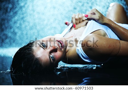 sexy woman in water studio