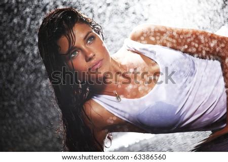 sexy woman in water studio - stock photo