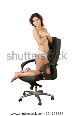 Sexy woman  kneeling on armchair. Isolated on white background - stock photo