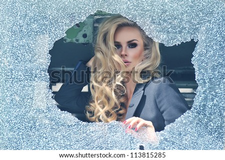 Sexy woman looks out the window - stock photo