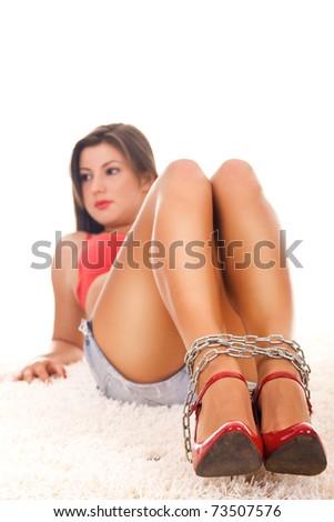 sexy woman lying on floor with binding legs - stock photo