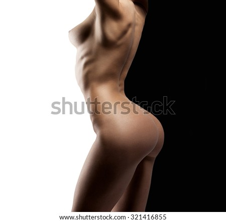 Sexy woman naked body. Nude sensual woman erotic buttocks back isolated on black - stock photo