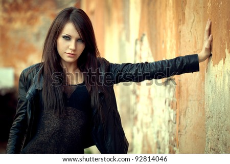 sexy woman near old wall - stock photo