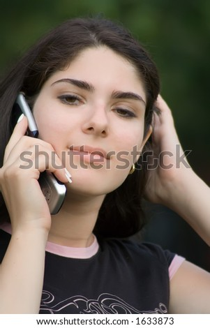 Sexy Woman on a Cell Phone - stock photo