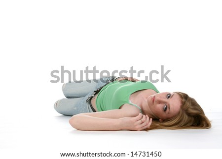 sexy woman on her back on the floor - stock photo