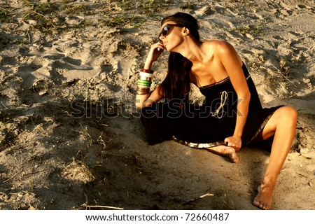 Sexy woman on the beach - stock photo