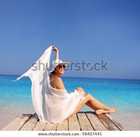 Sexy Woman on the beach against azure sea - stock photo
