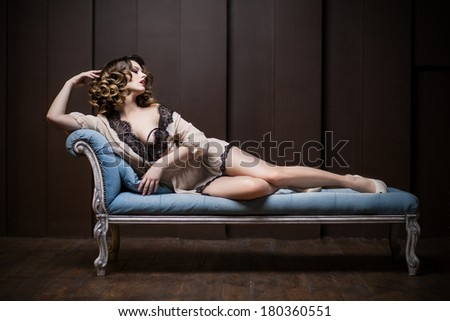 sexy woman on the couch - stock photo