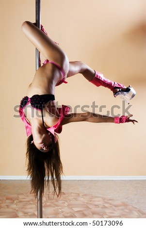 Sexy woman on the pole - stock photo