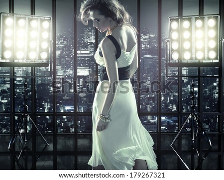 Sexy woman over city background - stock photo