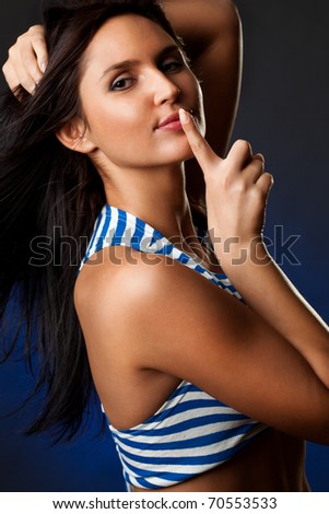 sexy woman portrait wearing striped costume showing hush - stock photo