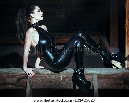 Sexy woman posing in catsuit, desire - stock photo