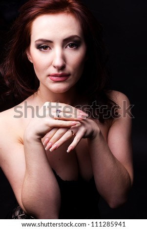 sexy woman  posing over dark background