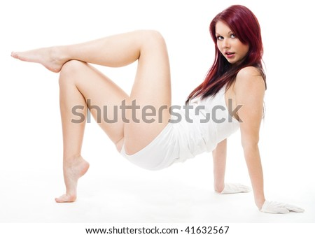 sexy woman posing standing on her hands - stock photo