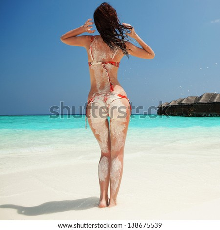 Sexy woman relax on the summer beach - stock photo