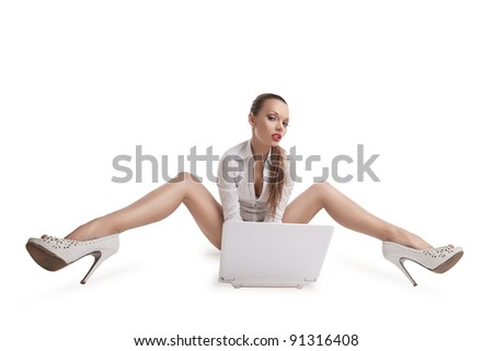 sexy woman sit with notebook and long legs - stock photo