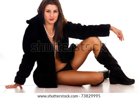 sexy woman sitting in coat with panties and boots - stock photo