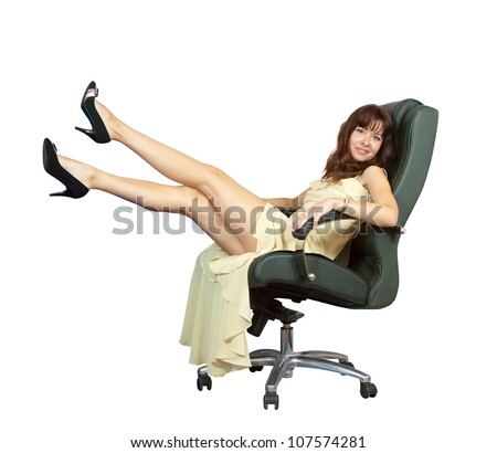 Sexy woman sitting on luxury office armchair, isolated over white background - stock photo