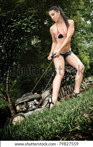 Sexy Woman Starting a Lawn Mower - stock photo
