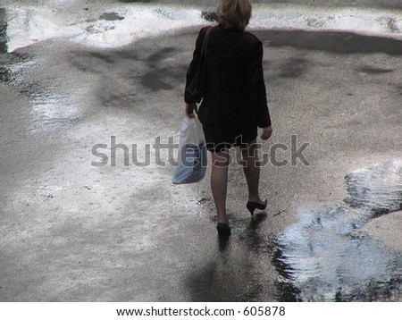 sexy woman strolling after the rain