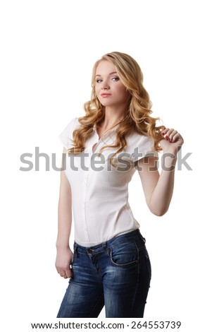 Sexy woman twists her hair strand on finger - stock photo