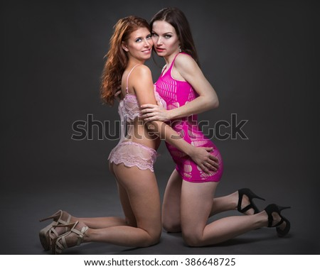 Sexy woman , two lesbian lovers foreplay - stock photo