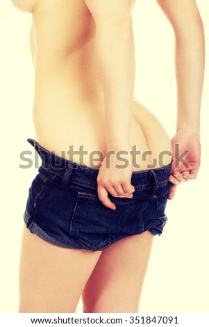 Sexy woman undressing her jeans shorts.