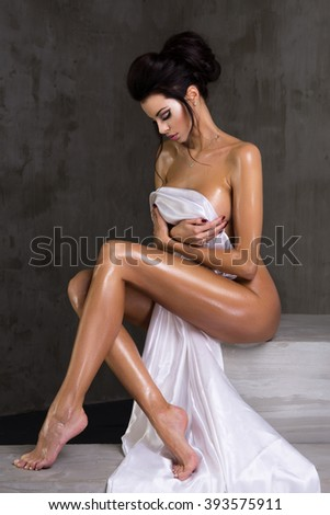 Sexy woman wear only white material in studio  - stock photo