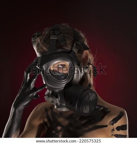 Sexy Woman wearing a Ammo Gas Mask, studio - stock photo