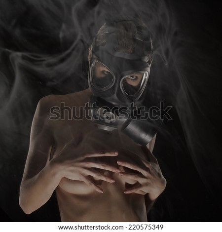 Sexy Woman wearing a Ammo Gas Mask, studio, with fog - stock photo