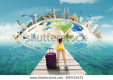 Sexy woman wearing bikini on the jetty with bag, enjoy freedom and trip to the worldwide monuments - stock photo